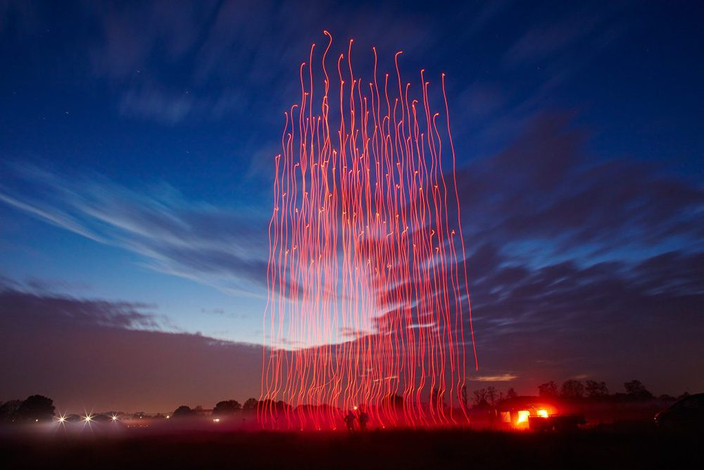 "An even 100 drones took to the air over Tornesch, Germany, on the evening of Nov. 4, 2015, to create Drone 100. The elaborate marriage of music and light and flight was the result of months of effort by Intel Corp. engineers and Ars Electronica FutureLab digital artists. Their sky-filling artwork was accompanied by an orchestra on the ground and fully enabled by Intel-powered PCs. All their efforts were rewarded with a Guinness World Records citing for the ""most unmanned aerial vehicles airborne simultaneously."" (Credit: Intel Corporation)"