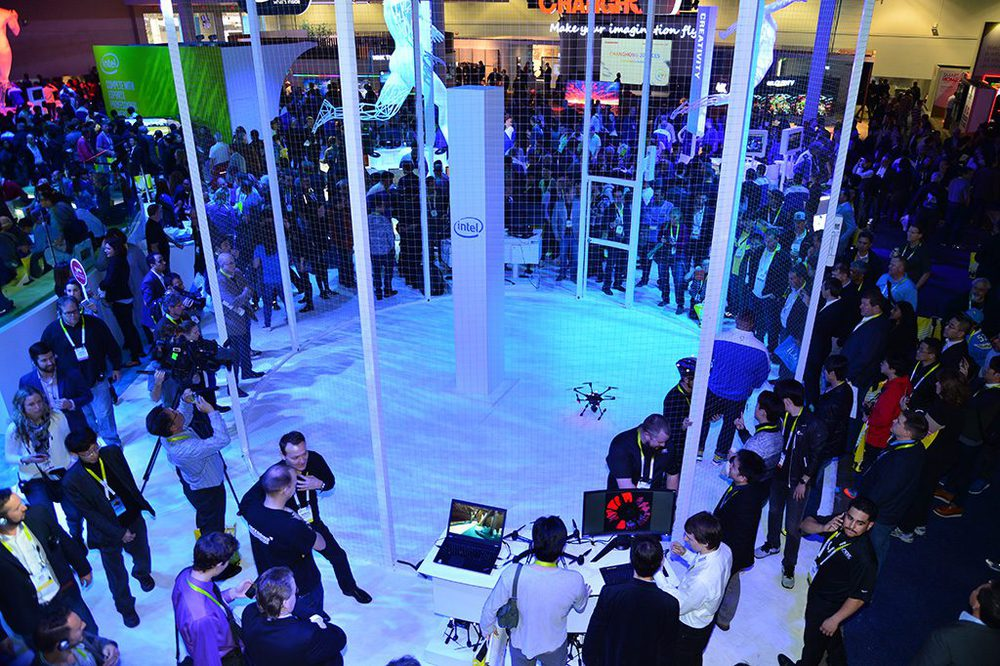 Unmanned aerial vehicles circle in a protected area of Intel's display space. Built with Intel RealSense technology, the drones are able to avoid collisions. Intel CEO Brian Krzanich demonstrated the Yuneec Typhoon H with Intel RealSense technology during his keynote address at the International Consumer Electronics Show. The drones were on display Wednesday, Jan. 6, 2016, in Intel's display area at the 2016 International Consumer Electronics Show. CES, the leading forum for the world's consumer technology leaders, runs Jan. 5-9, 2016, in Las Vegas. (Credit: Intel Corp./Walden Kirsch)
