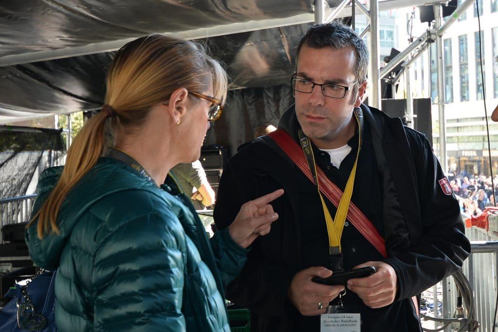 Stefan Lohmann gemeinsam mit Pressesprecherin Michaela Susan Pollok beim Tag der Deutschen Einheit in Frankfurt.