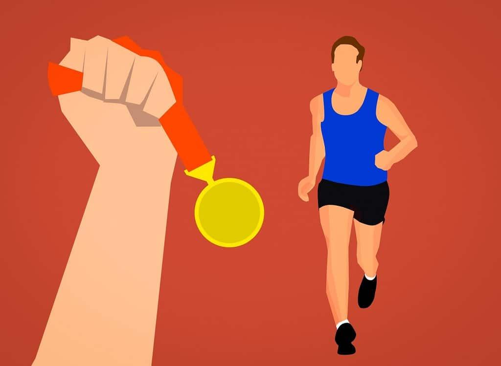 Mann läuft Richtung Medaille