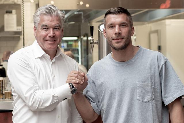 Johannes Molderings, Geschäftsführer von lemonpie, und Lukas Podolski