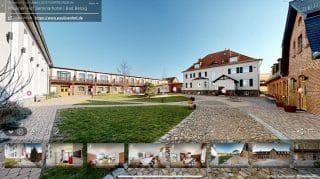 """Beim """"Klick"""" auf die Touchpoints, öffnet je ein 3D-Rundgang durch den ausgewählten Gebäudeteil des Paulinen Hof."""