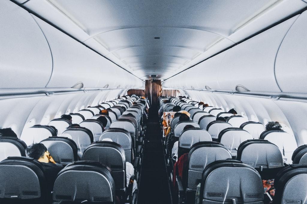 Flugzeug-Kabine-Passagier